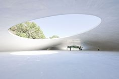 Teshima Art Museum by Ryue Nishizawa. A thin shell created by pouring concrete over a hill of earth.