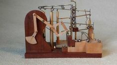 Marble Machine using Peaucellier's rotary to linear linkage machanism