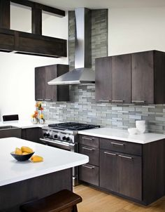 Dark cabinets, white walls and counter, mixed gray backsplash  Oceanside Glasstile Elevations Platinum modern kitchen