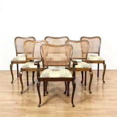 This set of 6 dining chairs are featured in a solid wood with a glossy dark walnut finish. These dining chairs have curved woven cane backs with yellow and white striped floral print seat cushions. Cottage chic chairs perfect for formal or casual dining! #americantraditional #chairs #diningchair #sandiegovintage #vintagefurniture