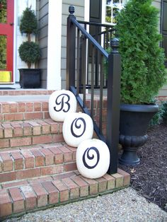 "Selling your house in October? Why not inspire this good idea. Paint pumpkins white with exterior spray and stencil the letters to spell ""Boo"". Tasteful and won't smell like rotting pumpkins."