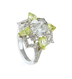 Asscher Cut White and Yellow Diamond Ring. Asscher and pear shape diamonds in platinum.