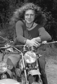 Robert Plant riding a motorbike at Frenchs Forest in Australia, 1972.