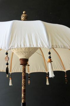 Inside Out - tips for taking your living space outdoors Featuring the boho beaded cotton garden umbrella from Rockett St George
