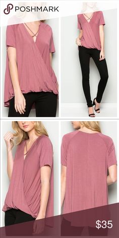 Pink Top. Not your basic T Pretty pink top that's not your basic tshirt. Dressed up or down this has a feminine touch that hangs with a generous flow. So many ways to wear. Put a choker on for accent and throw leggings on. Out the door looking good in minutes. October Love Tops