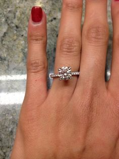 I have a feeling this is more of a 1.8 center stone, but if you don't get an outrageous band the money saved can go towards this look <3 Which in my opinion is perfect <3