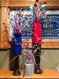 4th of July decorations made from PVC pipes rapped with fabric.
