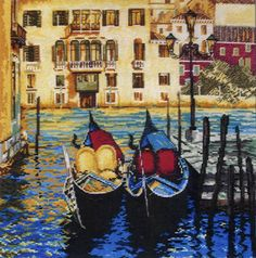An attractive picture from the romantic Italian city Venice with gondolas bobbing in the canal and houses rising straight from the water.