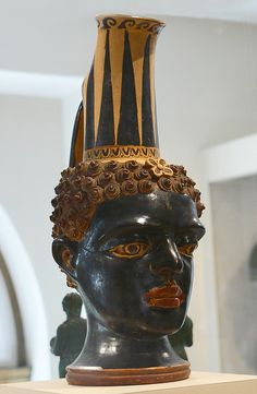 Terracotta vase combining the distinctive neck of the Shape VII oinochoe with a naturalistic head of a young black-African boy Etruscan 4th century BCE