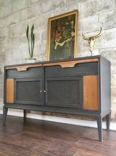 "This is a stunning solid wood mid century buffet, sideboard, or credenza by Basic Witz. Basic Witz was a furniture company based out of Virginia, that made quality mid-century furniture until bought out by Stanley Furniture.  Refinished this piece in a dark slate grey and hand waxed it for protection. The side wooden panels and the drawer tops were refinished in a walnut stain. The brass hardware is all original and the minimal distressing pairs wonderfully with it.   L-48"" D-15"" H-28.25"""