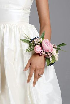 Wrist Corsage Of Pink Peonies, Pink Wax Flower, White Garden Roses, Blue Privet Berries, & Green Foliage****