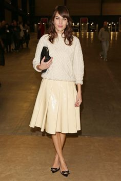 Alexa Chung: Chunky sweater paired w/ leather skirt