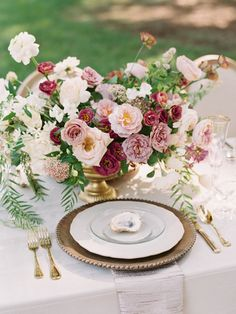 Pink, Burgundy, dusty rose, mauve & white wedding flower centerpiece with a wood beaded charger, gold silverware & oyster escort card Dusty Rose Wedding, White Wedding Flowers, Floral Wedding, Boone Hall Plantation, Flower Centerpieces, Wedding Centerpieces, Mauve, Dusty Rose Color, Spring