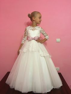 Please read our store policies before placing your order here https://www.etsy.com/ru/shop/Butterflydressua/policy  Beautiful white or ivory flower girl dress with multilayered skirt, corset with lace applique, zipper and lacing.  Item material: upper layer of the skirt- tulle with lace applique  middle layer of the skirt- tulle  lower layer of the skirt- taffeta corset- satin with lace applique  Dress color: ivory  white  Color of the sash: ivory  blush pink  red  ice blue  royal blue  navy…