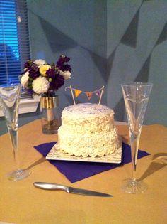 "Mini ""cutting "" wedding cake.  Pumpkin chocolate chip with vanilla buttercream.  Handmade cake topper."