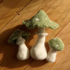 Forest mushrooms in green and white, set of three.