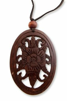 Coconut shell floral necklace, 'Blossoming Hibiscus' NOVICA. $19.95. Normally ships directly from Bali & Java within 10 days.. Handmade by Komang Agus Saputra.. A fair trade product. Save 58%!
