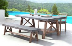 The Ford Dining Set will bring strength and style to your outdoor dining space. Solid wood base with cement top.