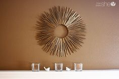 Make a sunburst frame from drinking straws, hot glue, and spray paint.