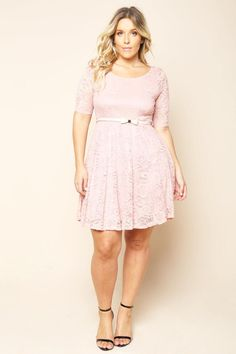 A plus size mini dress with a round neckline and short sleeves. Features a belted waist. Floral lace all over.