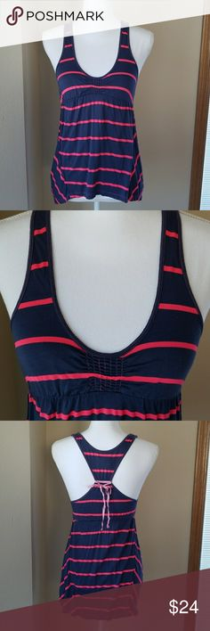 Free People high low tank top Free People high low tank top with racer back.  Navy blue with bright pink stripes. Free People Tops Tank Tops