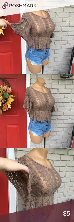 Taupe lace crop top Bates by sheer lace ruffle crop top. Elastic waist. Size Large but will fit Medium. THIS TOP HAS FLAWS. Lace shows wash/wear. There is a hole in front (see pic 5) and a large hole under left arm sleeve (see pic 8). $5 or FREE with purchase. If you'd like it with a purchase, just ask! Julie's Closet Tops Crop Tops