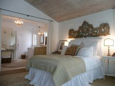 pretty bed and wall sculpture