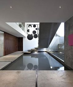Stylish Contemporary Concrete House by Mario Martins Atelier in Lagos: Small Indoor Pool Under The Floating Concrete Staircase In The House . Indoor Pools, Indoor Swimming, Modern Interior, Home Interior Design, Mario Martin, Architecture Design, Contemporary Architecture, Contemporary Design, Moderne Pools