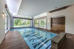 Hotels & Resorts, Contemporary Villa Interior Design With Green Surroundings By Centric Design Group: Indoor Swimming Pool Combined With Wooden Floor