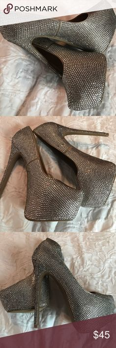 Steve Madden Glitter Pumps rhinestones all over both shoes. a few may be missing in some places, but still look good on. good condition, worn once. heel height is about 5 inches. could not find size, but i wear a 8.5 and they fit. Steve Madden Shoes Heels