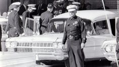 "After 2 p.m., Jacqueline Kennedy leaves Parkland Hospital with her slain husband's body. She would ride in the back with the bronze casket. ""I had a feeling that if somebody had literally fired a pistol in front of her face that she would just have blinked,"" said Dallas Police Officer James Jennings, who helped put the casket in the hearse."