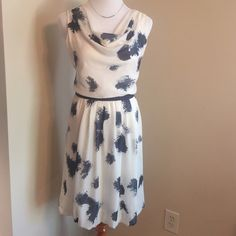 """Navy & White Splatter Print NWT Dress by LOFT This beautiful navy and white splatter print dress is going to be an amazing addition to your spring and summer wardrobe!  The fabric is very light and airy, yet fully lined. With a soft draped neck, navy ribbon detail at waist and bubbled hem at the bottom. It is brand new with the tags still attached and still in excellent condition.   Bust: 21"""" Waist: 16"""" Hips: 22"""" (lining measured)  Length: 38"""" Reasonable offers are always considered Smoke…"""