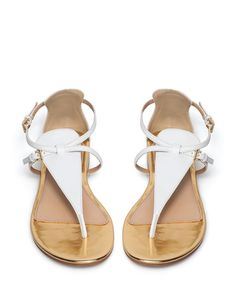 awesome gold and white sandals <3