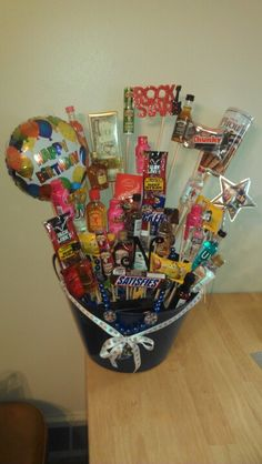 Boosie basket! Made by me! I'm so proud of it.  .  It has liquor candy and jerky! It only cost 55 for everything!