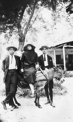 Two young men pose next to a young woman sitting on a mule. Greece Pictures, Old Pictures, Michael Chabon, Moise, Male Poses, Human Emotions, Thessaloniki, The New Yorker, Young Man