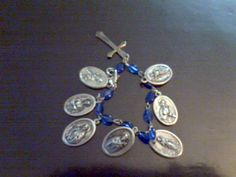 Collect Catholic Saint Medals based on each virtue and create a charm bracelet for your Little Flower