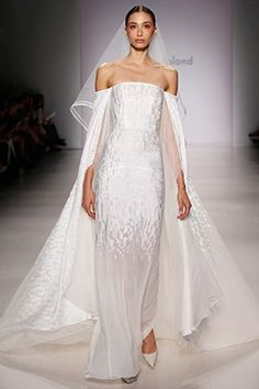 Pamella Roland makes a beautiful piece with veil, and cap sleeves that leave a train to follow behind her.