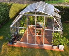 Enjoy modern gardening with a classic 'Barn shape' style all in a large semiprofessional greenhouse. The Americana 12 x 12 greenhouse provides a high head room and a large interior space for growing t
