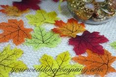 Place these miniature silk maple leaves on tabletops or decorate favors and invitations in a colorful fall theme. Reuse after the wedding for rustic autumn events such as Thanksgiving or Halloween. yourweddingcompany.com