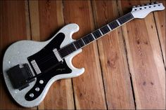Migma - German-made pearloid-finished solidbody electric guitar