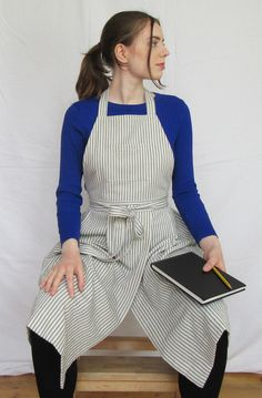 Incredibly flattering and attractive, yet superbly functional potters apron. Pleated skirt and front split allows plenty of movement whilst ensuring each leg is perfectly covered when sitting at the wheel or work bench. 3 pockets for tools etc - long waist ties can be knotted at the front for extra security. Split Legs, Ticking Stripe, Aprons, Blue Tops, Pleated Skirt, Work Wear, My Design, Ties, Cotton Fabric