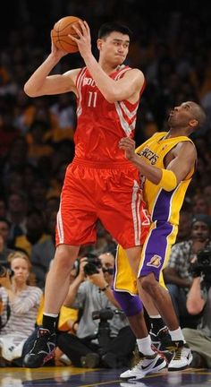 Yao and Kobe! If anyone can make Kobe look small, other than Shaq.