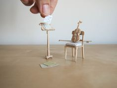 In this tutorial you will learn how to make your own tiny violin and bow. It is a difficult job, and not for the faint of heart! Dollhouse Miniature Tutorials, Diy Dollhouse, Dollhouse Miniatures, Tiny Violin, Violin Bow, Miniature Furniture, Dollhouse Furniture, Miniature Rooms, Miniature Crafts