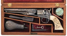 L.D. Nimschke New York Retailer Engraved and Cased Colt Model 1862 Police Percussion Revolver.