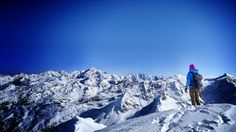 Arc'athlete Tanja Schmitt on the summit of Ormelune / Archeboc, with Mont Blanc in the distance.