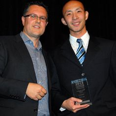 Donald Chen receives the Pro Bono Award from Paul Burgess on behalf of Salvos Legal's Luke Geary at the 2012 Lawyers Weekly Law Awards