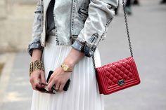 Chanel boy wallet in a chain.