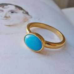 Turquoise Ring - Jane Austen - Gold | Jane Austen Gift Shop - I just fell in love with this ring watching the Kelly Clarkson Christmas special. She bought the original, but eventually had to settle for the replica - long story. This ring is amaze-balls.
