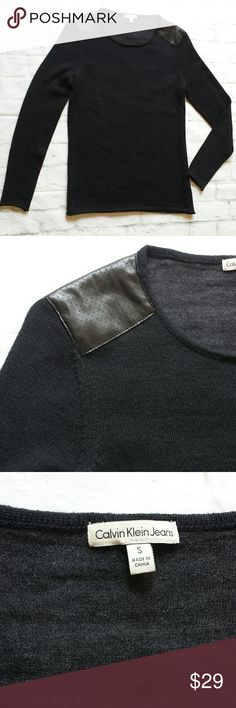 Calvin Klein Jeans Faux Leather Shoulder Contrast Sweater is in great condition.  Great faux leather shoulder detail as well as a contrasting gray back.   Approximate measurements:  - armpit to armpit 17 1/4 inches - length 26 inches - sleeve 24 inches  No trades.  Please submit any offers via the offer option. Calvin Klein Sweaters Crew & Scoop Necks