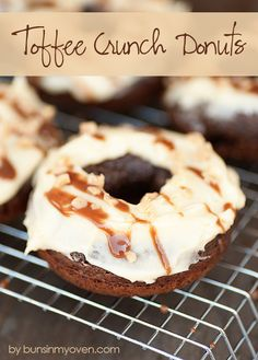 Toffee Crunch Donuts with Toffee Frosting, Sundae Chocolate Topping, and Heath bits on top of an easy baked donut from Buns In My Oven